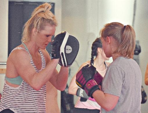 UFC Champ, Holly Holm with IncredAble Adaptive MMA athlete, Autumn Weinberger.